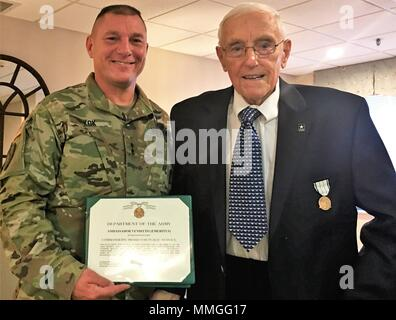 U.S. Army Reserve Ambassador (Emeritus) Carl R. Venditto of Connecticut receives the Public Service Commendation Medal and Patriotic Civilian Service Lapel Pin from Maj. Gen. Troy Kok, commanding general of the U.S. Army Reserve's 99th Readiness Division, during a ceremony in Southington, Connecticut. Also attending the ceremony was ARA (Emeritus) Ronald E. Weil Sr. of Connecticut, as well as ARA's George H. Duell Jr. of Pennsylvania, Robert Hill and Lewis P. Vasquez of Connecticut, and John des Groseilliers of Vermont. - Stock Photo