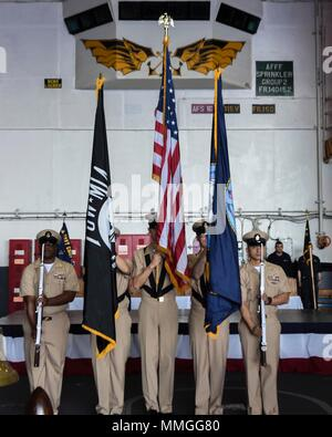 170915-N-AC117-070 YOKOSUKA, Japan (Sept. 15, 2017) -- The khaki color guard presents the colors during the Chief Petty Officer pinning ceremony on board the Navy's forward-deployed aircraft carrier, USS Ronald Reagan (CVN 76). Ronald Reagan provides a combat-ready force that protects and defends the collective maritime interests of the U.S. and its allies and partners in the Indo-Asia-Pacific region. (U.S. Navy photo by Mass Communication Specialist 3rd Class Macadam Kane Weissman/Released) - Stock Photo