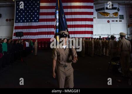 170915-N-AC117-082 YOKOSUKA, Japan (Sept. 15, 2017) Chief Hospital Corpsman Anthony Burdious leads the khaki color guard to parade the colors during the Chief Petty Officer pinning ceremony on board the Navy's forward-deployed aircraft carrier, USS Ronald Reagan (CVN 76). Ronald Reagan provides a combat-ready force that protects and defends the collective maritime interests of the U.S. and its allies and partners in the Indo-Asia-Pacific region. (U.S. Navy photo by Mass Communication Specialist 3rd Class Macadam Kane Weissman/Released) - Stock Photo