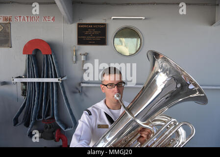180507-N-IG616-3860 TAMPA, Florida (May 7, 2018)  Musician 3rd Class Zachary Buckwash, from Dillsburg, Pennsylvania performs on tuba with the Navy Band Southeast 'Windward Brass Quintet' for the Navy Week Tampa Opening Ceremony aboard the SS American Victory Mariners Museum.  Navy Weeks are designed to connect the public with Navy Sailors, programs and equipment throughout the country.  (U.S. Navy/Released) - Stock Photo