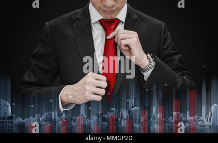 Businessman tying red necktie and raising graph diagram with building technology. Business growth and investment - Stock Photo