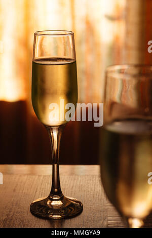 Flutes filled with sparkling prosecco, in a restaurant in Conegliano. Prosecco is a white sparkling wine cultivated and produced in Valdobbiadene - Stock Photo