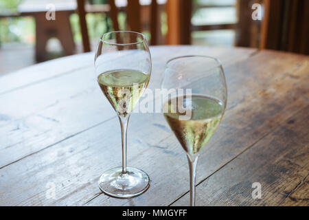 Flutes filled with sparkling prosecco, in a restaurant in Conegliano. Prosecco is a white sparkling wine cultivated and produced in Valdobbiadene-Cone - Stock Photo