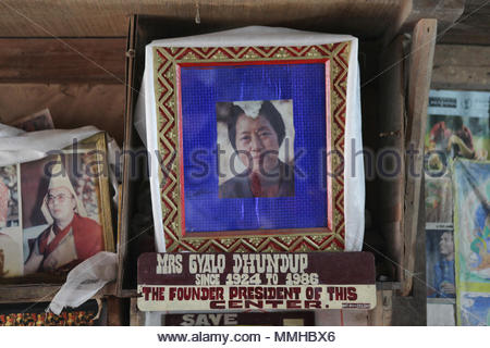 A photo of Mrs. Gyalo Dhundup (1924-1986) who was the Founder President of the Tibetan Refugee Self-help Centre in Darjeeling, India rests on the 'God - Stock Photo