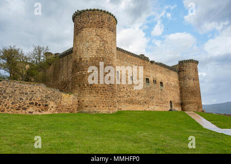 Main facade of the castle of the town of El Barco or Valdecorneja castle built in the twelfth century and rebuilt in the fifteenth century. Community  - Stock Photo