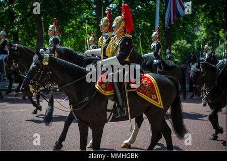 LONDON - JUNE 17, 2017: Royal guards on horseback dressed in ceremonial uniform pass down the Mall. - Stock Photo