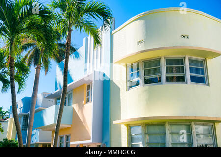 Typical pastel-colorfed 1930s Art Deco architecture with palm trees in Miami, Florida - Stock Photo