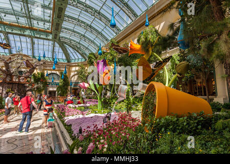 Tourists visiting Bellagio's Conservatory & Botanical Gardens in the Billagio Luxury Resort and Casino on the Las Vegas Strip in Paradise, Nevada - Stock Photo