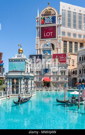 Gondoliers carry tourist passengers on gondola rides at the Venetian Resort Hotel Casino on the Las Vegas Strip in Paradise, Nevada - Stock Photo