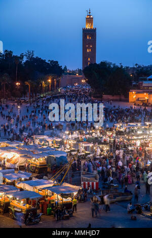 Marrakesh, Morocco; view of the Djemaa el Fna at sunset. - Stock Photo