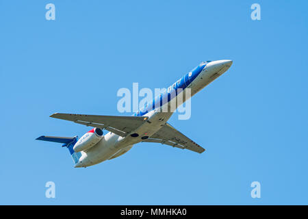 Embraer ERJ-145-EP, twin-engine regional jet from British Midland Regional Limited / Flybmi, British regional airline in flight against blue sky - Stock Photo
