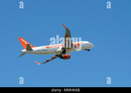 Airbus A320-214 WL, commercial passenger twin-engine jet airliner from British low-cost carrier airline EasyJet in flight against blue sky - Stock Photo