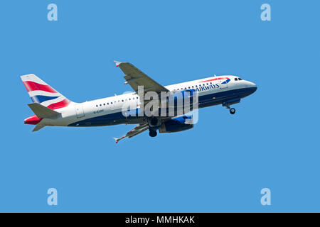 Airbus A319-131, narrow-body, commercial passenger twin-engine jet airliner from British Airways in flight against blue sky - Stock Photo