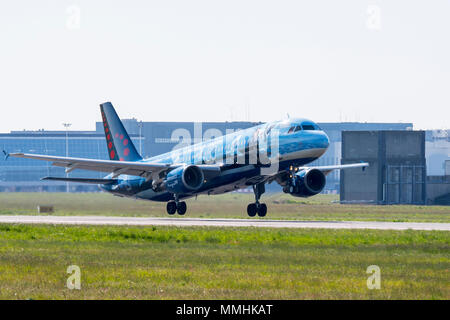 Airbus A320-214 in Magritte livery, commercial passenger twin-engine jet airliner from Belgian Brussels Airlines taking off from Brussels Airport - Stock Photo
