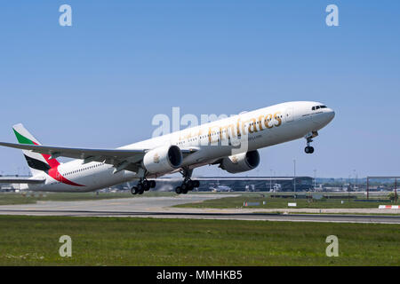 Boeing 777-300ER, long-range wide-body twin-engine jet airliner from Emirates, airline based in Dubai, United Arab Emirates taking off from runway - Stock Photo