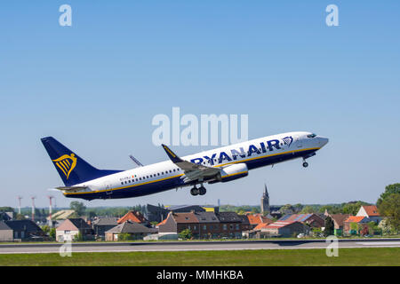 Boeing 737-8AS, short- to medium-range twinjet narrow-body airliner from Ryanair DAC, Irish low-cost airline taking off from runway - Stock Photo