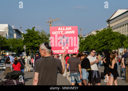 Berlin, Germany - may, 2018: Man holding sign for religous tolerance, praising God, Allah and Jawe (Yahweh) in Berlin,  Germany - Stock Photo