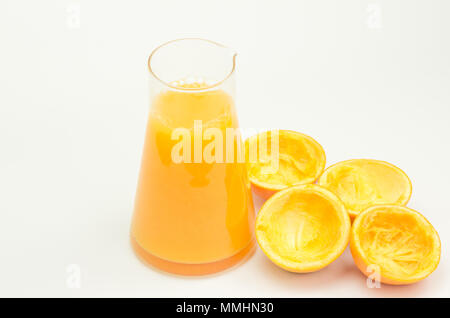 freshly squeezed oranges in a glass - Stock Photo