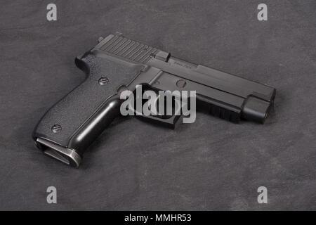 sig sauer hand gun on black - Stock Photo