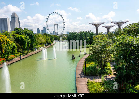 Singapore park with Super Trees, Singapore Flyer and city skyline - Stock Photo