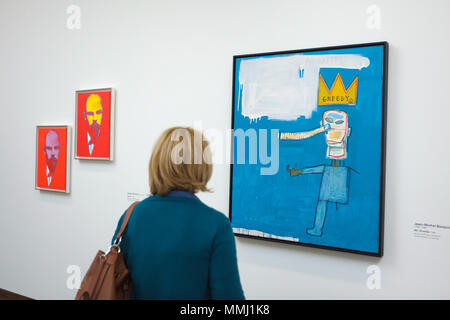 Visitors in front of the painting 'Mr Greedy' (1986) by US artist Jean-Michel Basquiat displayed at the exhibition 'WOW! The Heidi Horten Collection' in the Leopold Museum in Vienna, Austria. The exhibition presenting the masterpieces from one of the most impressive European private collections runs till 29 July 2018. Paintings 'Lenin' by US painter Andy Warhol are seen in the background. - Stock Photo