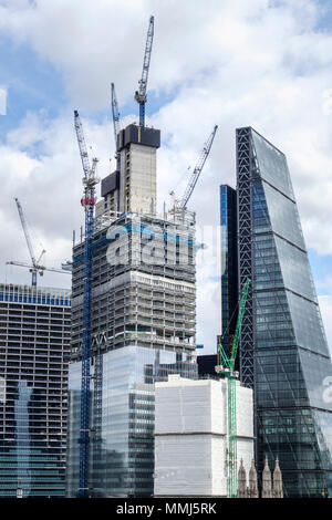 New development in the City of London financial district: 22 Bishopsgate under construction next to the Cheesegrater, 100 Bishopsgate behind - Stock Photo