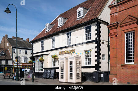 A public house with vintage telephone kiosks in street on a fine spring morning in Beverley, Yorkshire, UK. - Stock Photo