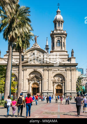 People walking in front of Metropolitan Cathedral, Plaza de Armas, Santiago, Chile, South America - Stock Photo