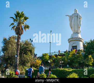 People on Easter Sunday, Virgin of Immaculate Conception statue, top of San Cristobal hill, Santiago, Chile, on Easter Sunday - Stock Photo