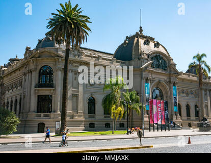 National Museum of Fine Arts, Santiago, Chile, South America, on quiet Easter Sunday with no traffic and people walking along pavement - Stock Photo