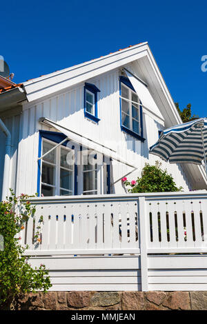 House with sunny terrace in summer - Stock Photo