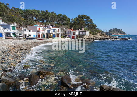 Spain old fishermen houses on the waterfront, Cala S'Alguer cove in Palamos, Mediterranean sea, Costa Brava, Catalonia, Baix Emporda - Stock Photo