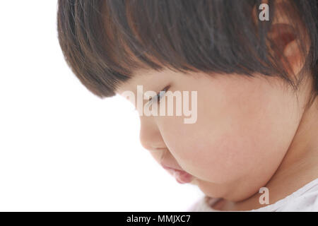 Side view on the child on studio background. Close-up photo - Stock Photo