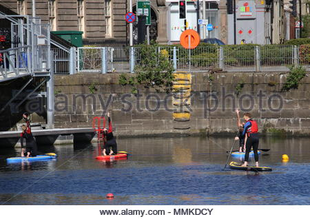 Dundee, UK. 12th May 2018. People starting a sunny day in Dundee with yoga on float boards at Foxlake City Quay Dundee.  © Stephen Finn/Alamy Live News - Stock Photo