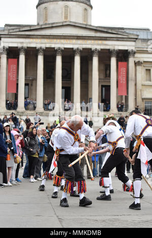 Trafalgar Square, London, UK. 12th May 2018. Morris dancers from all over England join the Westminster Morris People for a Day of Dance. Credit: Matthew Chattle/Alamy Live News - Stock Photo