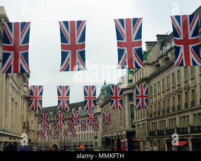 London, UK. 12th May 2018.  - Union flags hangs above LondonÕs Regent Street ahead of the Royal Wedding of Prince Harry and  Meghan Markle on 19 May 2018 at St George's Chapel in Windsor Castle. Credit Roamwithrakhee /Alamy Live News - Stock Photo