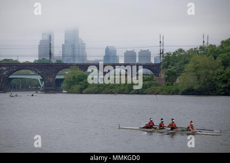 Philadelphia, PA, USA. 12th May, 2018. Rowers participate in the 80th annual Dad Vail Regatta on the Schuylkill River with the foggy city skyline in the background. Credit: Michael Candelori/ZUMA Wire/Alamy Live News - Stock Photo