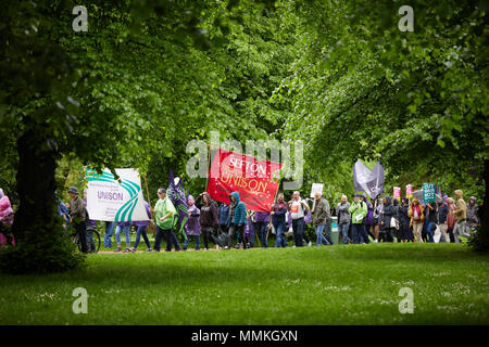 London, UK. 12th May 2018. London, UK. 12th May 2018. London, UK. 12th March 2018. Protestors march through a park in the rain towards a TUC rally. Credit: Kevin Frost/Alamy Live News Credit: Kevin Frost/Alamy Live News Credit: Kevin Frost/Alamy Live News - Stock Photo
