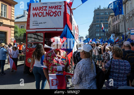 Warsaw, Poland. 12th May 2018. Thousands of Poles marched in Warsaw in March of Freedom to demand respect for country's constitution while denouncing a populist government that they accuse of eroding democracy. Credit: Jacek Kadaj/Alamy Live News - Stock Photo