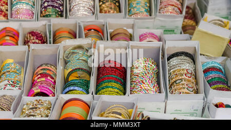 A closeup photo of boxes of colourful bangles. The assortment of bangles were on display for sale at Shilparamam, Hyderabad, India. - Stock Photo