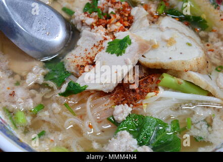 thin rice noodles with pork and fish line in soup on bowl - Stock Photo