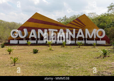 Big sign beside the road on a little hill of the Guantanamo province, Cuba - Stock Photo