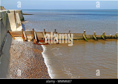 A seascape with a calm high water up to the seawall on the North Norfolk coast at Cromer, Norfolk, England, United Kingdom, Europe. - Stock Photo