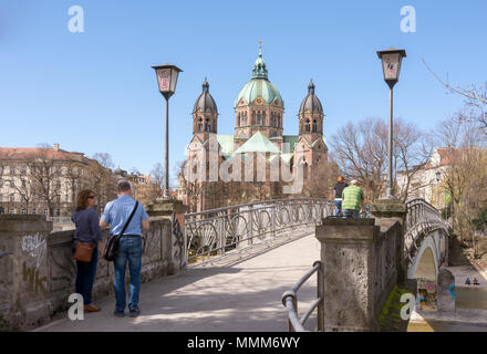 MUNICH, GERMANY - APRIL 4:  Tourists at a bridge to the Saknkt Lukas church in Munich, Germany on April 4, 2018. - Stock Photo