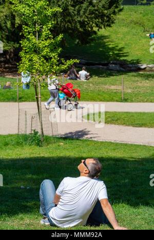 people picnicking, parc des buttes chaumont, paris, france - Stock Photo