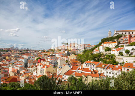 Panorama of the old town in Lisbon at sunny spring day,  Portugal.  On the hill   'Igreja e Convento da Graca'  Church. - Stock Photo