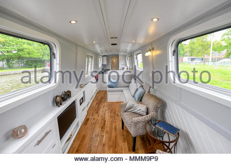 Wide angle shots of the interior of a new, modern narrowboat with a predominantly pale colour scheme. - Stock Photo