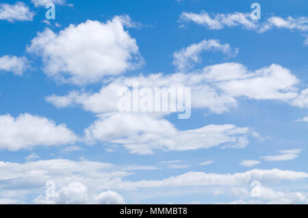 Beautiful Cumulus Clouds against a blue sky. - Stock Photo