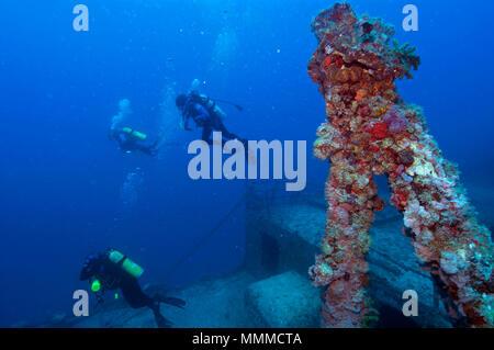 Scuba divers explore the shipwreck USS Spiegel Grove, Key Largo, Florida, USA - Stock Photo