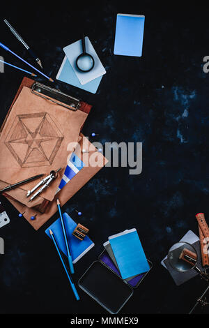 Architect or interior designer workplace, desk and design tools with construction material samples. Sketches, compasses, rulers, clipboards and pencil - Stock Photo